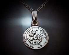 I deeply inscribed a hand drawn tight English style scrollwork pattern in this classic pendant. I paired this with an 18 inch sterling Figaro style chain. The silver disc is about 18 mm in diameter. Jewelry Crafts, Jewelry Art, Art Nouveau, Metal Engraving, Silver Lockets, English Style, Handcrafted Jewelry, How To Draw Hands, Sterling Silver