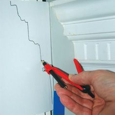 How to cut a piece of drywall around an intricate border or molding. | thisoldhouse.com #homeimprovementideas