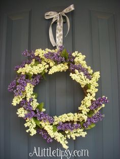"Make Your Own $6 Berry Wreath |  Crafter wrote ""I always loved those cute berry wreaths, but like many other things I thought ""I can make that."" So when I found stems of purple and white berries at the Dollar Tree, I had to do it, and I love it! Behold the $6 Spring Berry Wreath."""