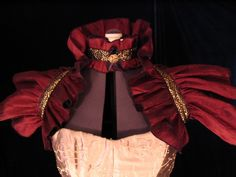 Victorian Ruffle Shrug. Gothic Couture Burgundy red with black and gold trim/ Steampunk/ Witch wear/Burlesque. $40.00, via Etsy.