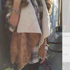 Faux suede Sherpa vest. NWOT Brown vest with super soft Sherpa lining. Can fit sizes 2-10. Jackets & Coats Vests