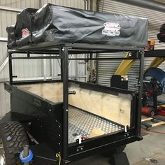 Mark's M-Series M416 trailer sports a telescoping frame tied rack which he made. An adjustable rack gives you the best of both worlds, lower center of gravity on the trail and tall roof top tent position in camp.