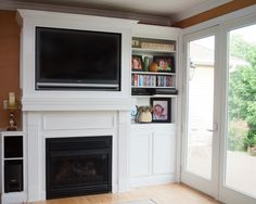Gas fireplace with built in book shelf and cabinet