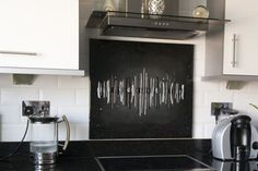 This Dalaman design splashback in Droylsden is created in black hues. It is fitted with our hanging system which allows fitting over existing tiles. This means that there's no need to mess up your house when installing the art, or when removing it. This option is favoured by some of our customers, as the panel is removable. However, we do not recommend this method for use with regards to splashback, as it could be more vulnerable to damage.