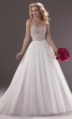 Sweet heart neckline, blinged out top,and full skirt part:)