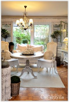 I love the used of the shutters by the windows. A lovely shabby chic room.