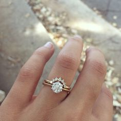 Curved band with solitaire round engagement ring