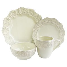 Offering charming appeal for your dining room table, this lovely earthenware dinnerware set showcases scalloped edges and a cream finish.   ...