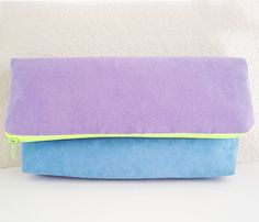 """Foldover Clutch  by Academe  This is a fully lined pouch with a full zipper closure along the top. A nice 1 1/2"""" box pleat in the bottom corners gives a little stability and shape. Bright green/yellow neon zipper along the top."""