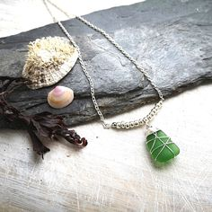 This is a simple boho style Irish seaglass pendant featuring seaglass and silver beads. It looks great when worn alone or alternatively mix it it up by layering it with other pieces! Elegant and sophisticated, yet romantic and earthy. I know that so many people, like me, feel the call of the sea and the salty breeze in Sea Glass Jewelry, Jewelry Box, Jewellery, Bohemian Style Clothing, Boho Style, Irish Jewelry, Beach Accessories, Boho Look, Silver Beads