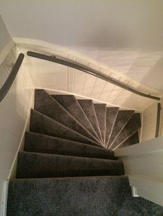 Tapijt met ondertapijt op de trap