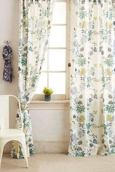 Pretty curtains. Something like this for the sliding glass door instead of the blinds. with blue and burgandy and offwhite, botanical print