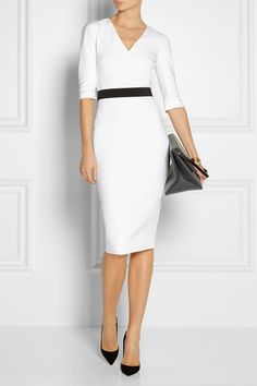 VICTORIA BECKHAM Stretch cotton-blend dress $1,895 Victoria Beckham's monochrome dress has the power to shape a sensational silhouette. Crafted with just the right amount of stretch, this cotton-blend design gently forms to your figure for an hourglass effect. Maximize the look with the detachable belt, keeping your accessories clean and slick. Shown here with: Arme De L'Amour bracelets, Maria Black bracelet and rings, Maison Martin Margiela ring, Christian Louboutin shoes, Stella McCartney…