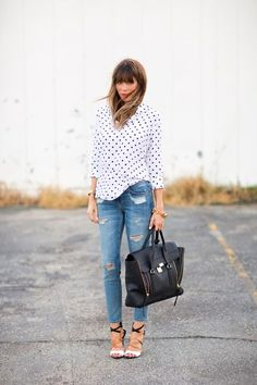 Polka dot button down, distressed denim, black and tan strappy heels, and black handbag