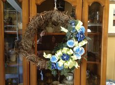 """I constructed the wreath from Spanish moss and Virginia creeper. I have dubbed the removable decoration a """"wreath corsage"""". It has felt backing and Velcro."""