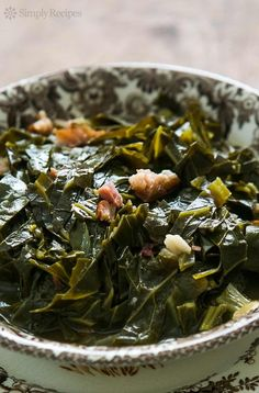 Southern Style Collard Greens! Slow cooked collard greens with a ham hock, onions, vinegar and hot sauce. A classic with BBQ! #Healthy On SimplyRecipes.com