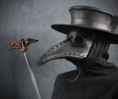 In order to help with your plague doctor costume we have recreated the winged hourglass that sits atop the staff represented in the engraving by Paul