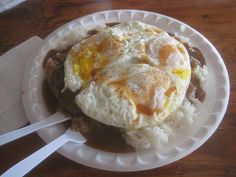 Another Hawaiian Favorite. When I was in Hawaii I ate this probably 12 times in a ten day period. I absolutely couldn't get enough.   It is simply 2 scoops of white rice a hamburger patty a fried egg and cover the whole thing with Brown gravy. Garnish with green onion. You can substitute spam for the hamburger or add it on the side. Great any time of the day.
