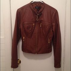 Bebe Multi Zip Motorcycle Leather Jacket This is a vintage leather Bebe jacket in cognac. It is 100% leather and looks as if it's new. The only signs of wear are beneath the sleeves and wrists as shown, and the underarm of the interior of the jacket. Already dry cleaned. It is heavy weight unlike some of Bebe's current leathers. bebe Jackets & Coats