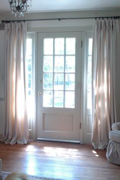 More hanging curtains by the front door. Nice way to hide a front door that goes straight into the living room in the evenings. Sidelight Windows, Home, Front Doors With Windows, House Styles, Windows And Doors, Interior, New Homes, House, Front Door Curtains