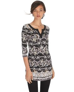 """Embroidered notch neckline lined with silvertone studs adds modern contrast this stretch knit 3/4 sleeve printed tunic. Stylist Note: Pair this long length printed tunic with sleek skinny jeans and an easy wedge for elevated weekend wear.    Contoured stretch fit.   Notch neckline with silvertone heat set studs.   3/4 sleeves.    95% polyester, 5% spandex. Machine wash, cold. Imported.   Approximately 31.5"""" in length from shoulder."""