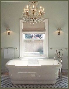 1930s inspired bathroom. Lose the chandelier.