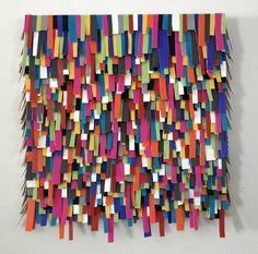 'Glitch' is a retro wall sculpture inspired by the world of 'glitch art'. Using mass ammounts of different coloured and sized vinyl strips then layering them onto one another creates a tactile surface bringing flat and 2-D classic 'glitched' images and colours to life with a 3-D presence.  This wall sculpture has all the necessary attachments to the back so that it is easy to hang on your wall.