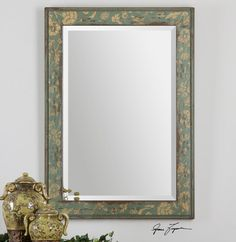 "Frame features a heavily distressed, aged blue green finish with antiqued ivory details. Mirror features a generous 1 1/4"" bevel. May be hung horizontal or vertical.   Dimensions: 25 W X 35 H X 2 D (in"