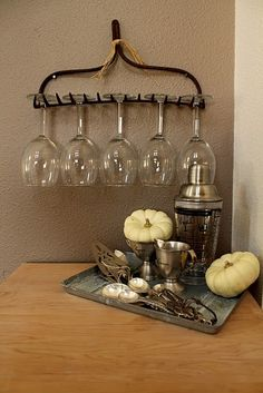 An old rake head mounted on the wall makes a perfect wine glass rack.