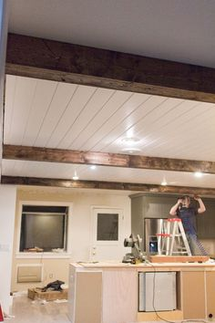 Kitchen Chronicles: DIY Wood Beams Use 45 degree angles on the edges to hide the join and give the appearance of a solid beam. Home Improvement Projects, Home Projects, Plafond Design, Faux Wood Beams, Diy Holz, Basement Remodeling, Basement Ideas, Dark Basement, Basement Layout