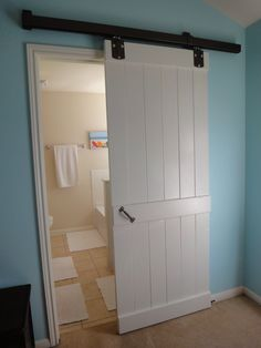 Farm house doors, I like the idea of having a door that doesn't swing out, it saves space to.