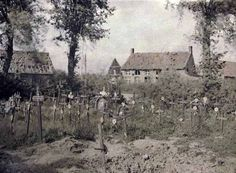 A War Cemetery in the Belgian village of Woesten; the village is just behind the frontline, not far from Ypres in Flanders. Photographed in 1917.