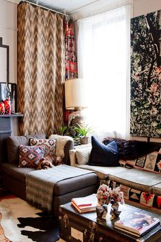 eclectic family room by Rikki Snyder... puzzle fit a chaise and sofa into a tight corner.... cozy