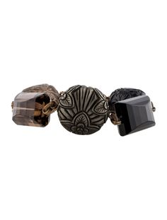 $275.00    Brass Stephen Dweck link bracelet with floral ornament at center featuring faceted and carved smoky quartz and black onyx stations and toggle and lobster clasp closures.