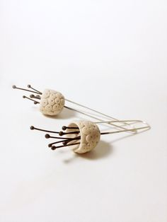 minimalistic hand sculped dotted bell flower polymer clay earrings in off white colour, made to order. $38,00, via Etsy.