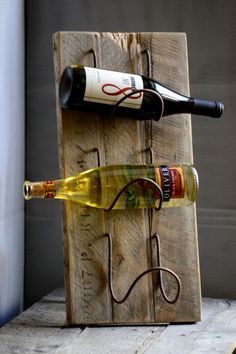 Rough plank tabletop wine rack by 413Collections on Etsy, $55.00 use as a towel holder in bathroom too