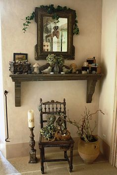 Huge corbels to hold up mantle-type shelf.  Floor candlestick, ornate chair, twiggy floral.
