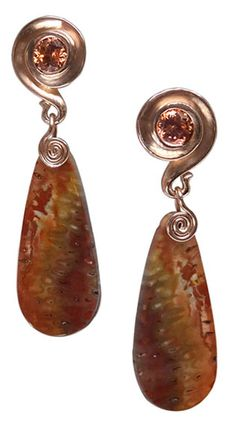 Nautilus earrings by Whitney Robinson. They're rose gold, and feature sparkling rose zircons in the tops with wonderfully patterned fossil fern drops.