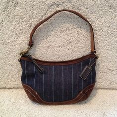 Denim and suede Coach bag This little bag is great with jeans. It is clean and in excellent condition inside and out.  Measures approx 10 x 6. Coach Bags