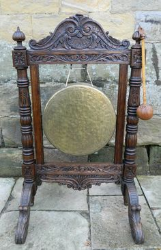 large floor standing dinner gong with striker in ornate carved oak frame with decorative hammered brass gong which has a very resonant sound when struck. Antique Photos, Get Directions, Carving, Victorian, Display, Flooring, Dinner, Antiques, Decor