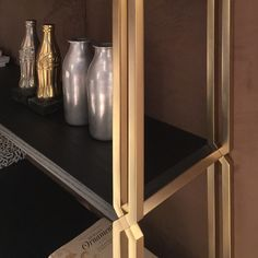"BDS Bookcase designed by Borromeodesilva for Paolocastelli Spa. The braided brass pillar create e ""V"" slot to fit the black ash shelves. Presented at the Salonedelmobile 2016, Fieramilano Rho, hall 7, stand G11"