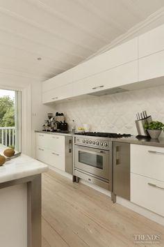 Great kitchen idea! Love the textured quilted backsplash in this kitchen design