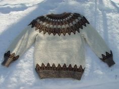 Traditional unisex Icelandic Lopi sweater worked in the round with stranded colorwork details and yoke.
