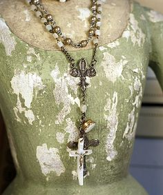 the dress is fabulous - the photograph is fabulous too - and - the jewelry is sheer fabulistic fabulousness!