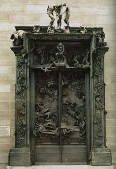 "Auguste Rodin's massive sculpture ""The Gates of Hell"" in the Rodin Museum in Paris. Commissioned to be doors for a new decorative arts center in Paris, Rodin died in 1917 before completing the work. The seated figure near the top was later recast, enlarged and is now known as ""The Thinker."""
