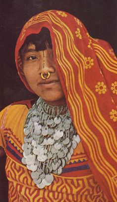 Panama    Cuna indian woman dons elaborate jewellery and face paint.  San Blas Islands.   Scanned image from the article entitled 'Panama, Link Between Oceans and Contents ~ Jules B Ballard and Bruce Dale' National Geographic, 1970,  page 433.