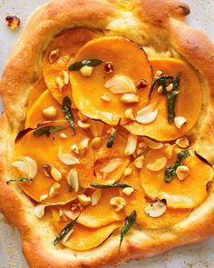 Butternut Squash Pizza with Hazelnut Dough Recipe -- layers of sage, squash, and a touch of garlic over nutty dough.