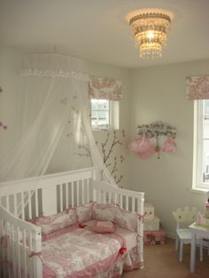 Beautiful girl's room. LOVE the light fixture and the blossoms on the wall.