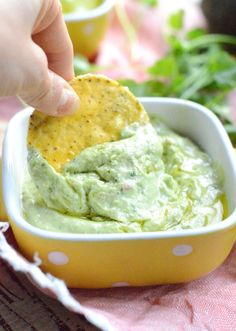 Simple avocado dip for chips, dairy free, creamy, healthy made of only 6 easy ngredients: avocado, cilantro, tahini and olive oil. A simple guacamole.