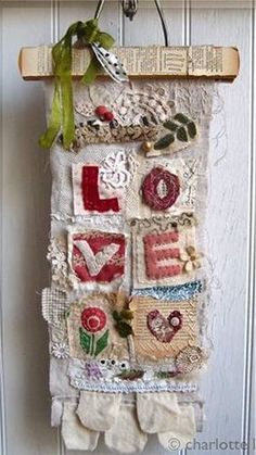 LOVE sampler - i really love the fabric layers and also the paper decoupaged onto the wood hanger - inspiration ******************************************** CharlotteLyons #fabric #collage #love t